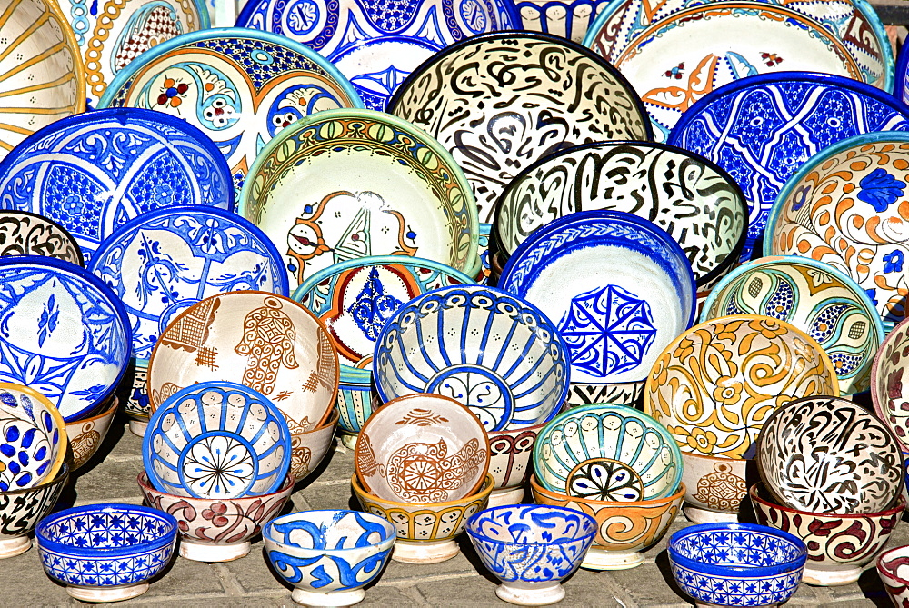 Earthenware plates and dishes from Fez, for sale in the street of the Medina,  Marrakech, Morocco, North Africa, Africa