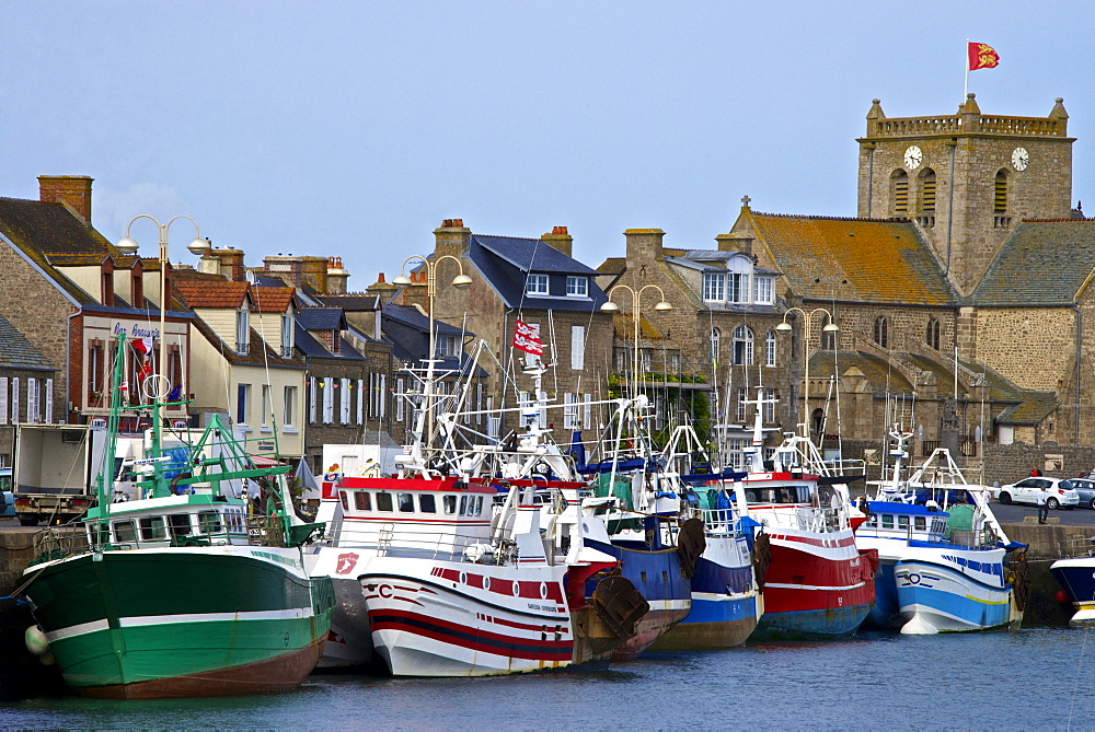Fishing boats and harbour, and 17th century church in the background, Barfleur, one of the loveliest French village, Cotentin, Normandy, France, Europe - 665-5490