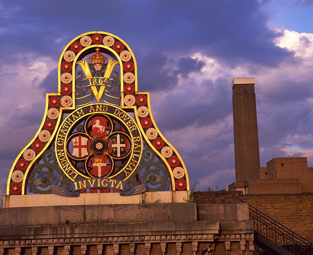 Railway sign on Blackfriars Bridge and Tate Modern behind, London, England, United Kingdom, Europe