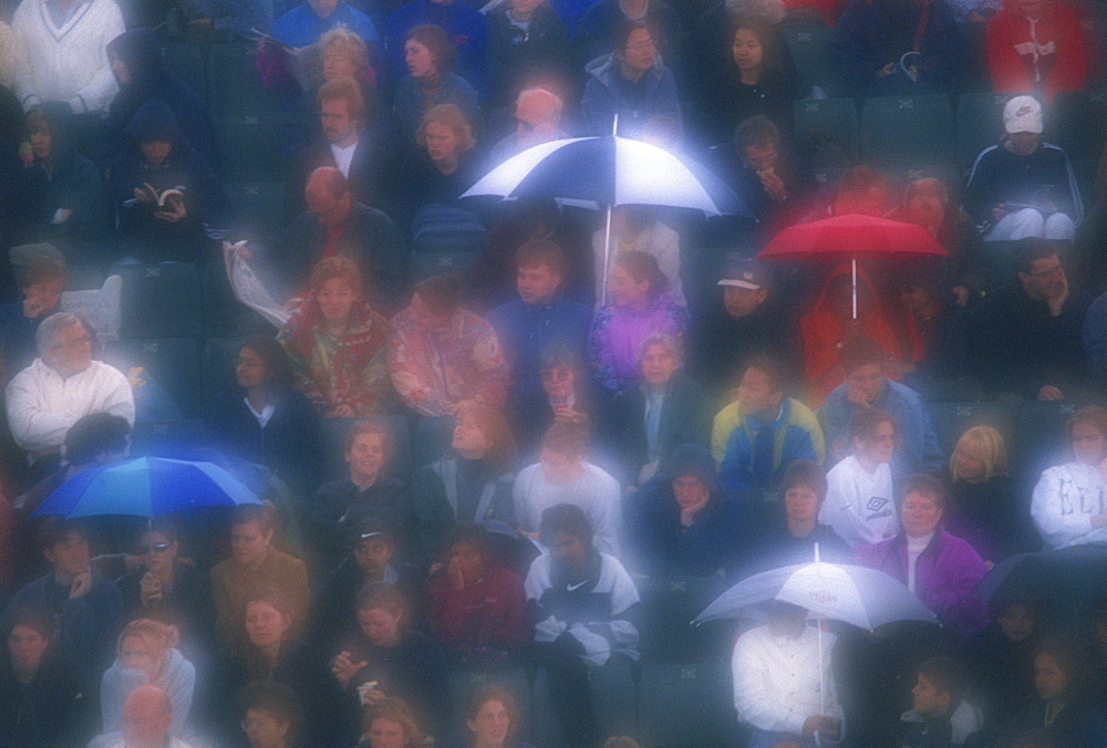 Diffuser filter used on shot of Wimbledon crowd in the rain, London, England, United Kingdom, Europe