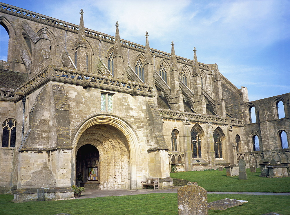 Norman arch and flying buttresses, Malmesbury Abbey, Malmesbury, Wiltshire, England, United Kingdom, Europe