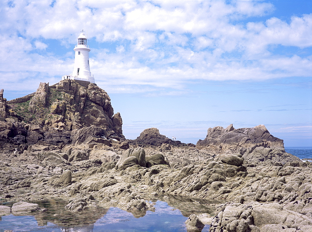 Lighthouse from the causeway at low tide, Corbiere, St. Brelade, Jersey, Channel Islands, United Kingdom, Europe