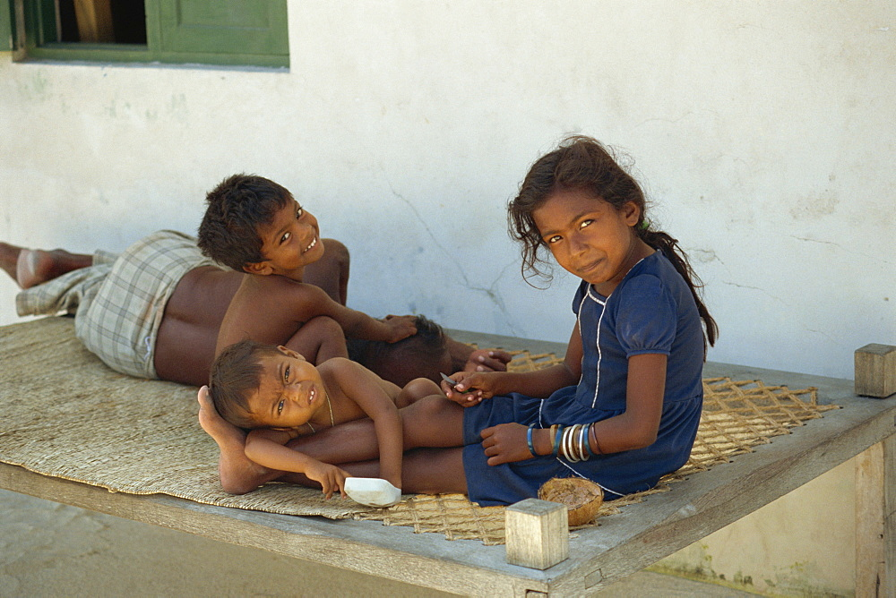 Portrait of a group of three small children, smiling and looking at the camera, Maldive Islands, Indian Ocean, Asia