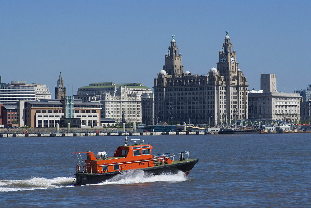 View of the Liverpool skyline and the Liver building, with a pilot boat in the foreground, taken from the Mersey ferry, Liverpool, Merseyside, England, United Kingdom, Europe