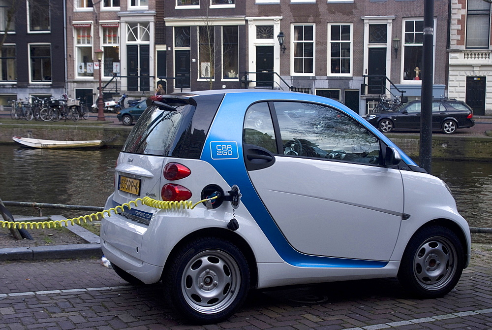 Charging an electric car, Amsterdam, Netherlands, Europe