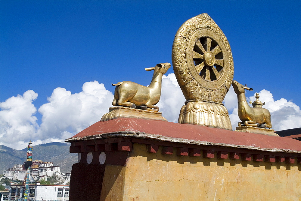 Jokhang Temple, the most revered religious structure in Tibet, with Potala Palace in the distance, Lhasa, Tibet, China, Asia