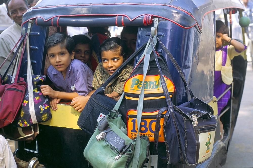 Children in autorickshaw, India, Asia