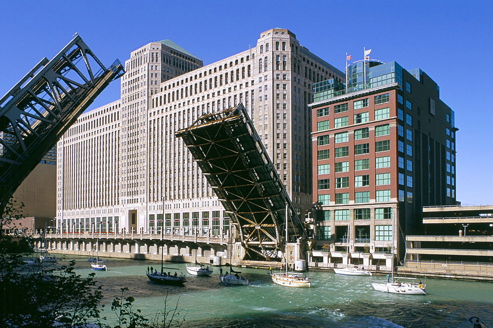 Two part bridge being raised over the Michigan canal, Chicago, Illinois, United States of America, North America