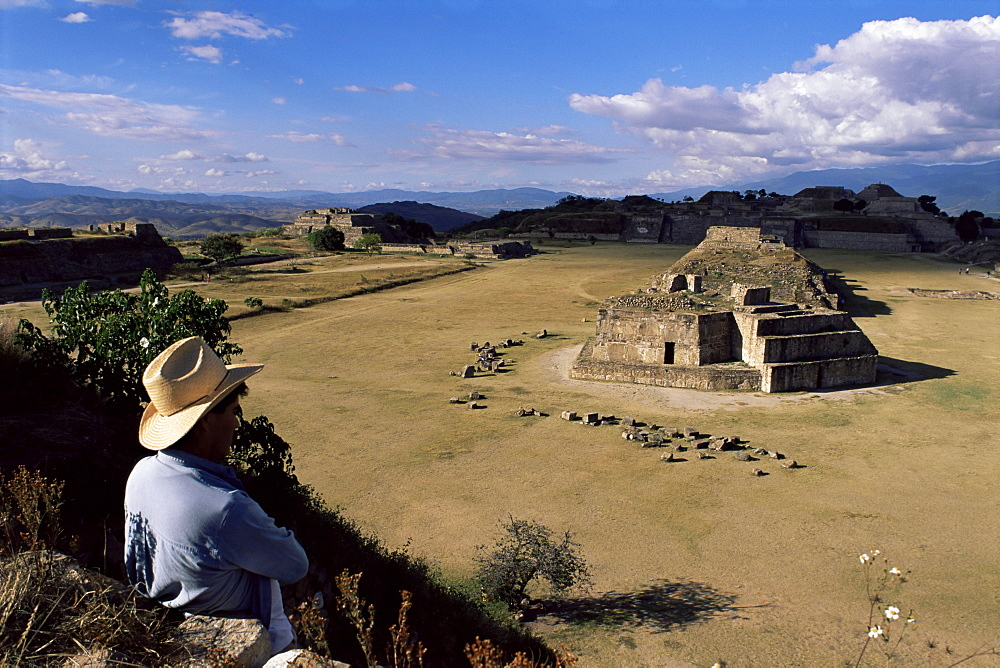 Tourist looking at the ruins of Monte Alban, UNESCO World Heritage Site, near Oaxaca, Mexico, North America
