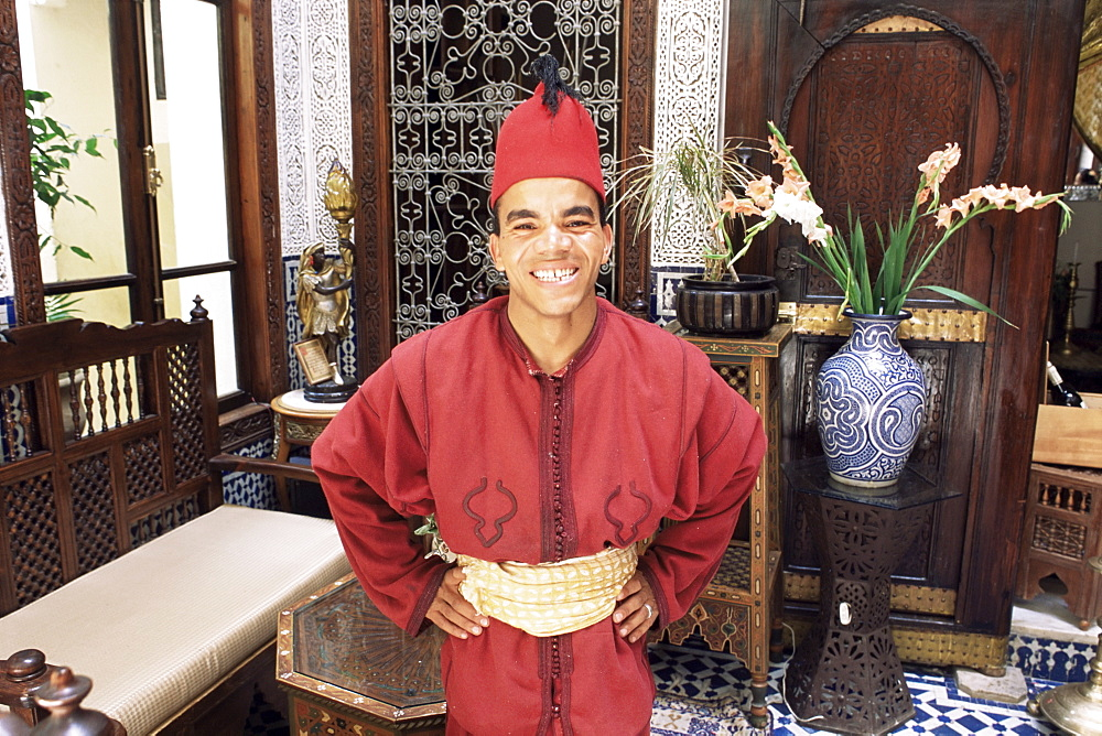 Portrait of a hotel worker in uniform, Hotel Ryad Arabesque, Fez, Morocco, North Africa, Africa