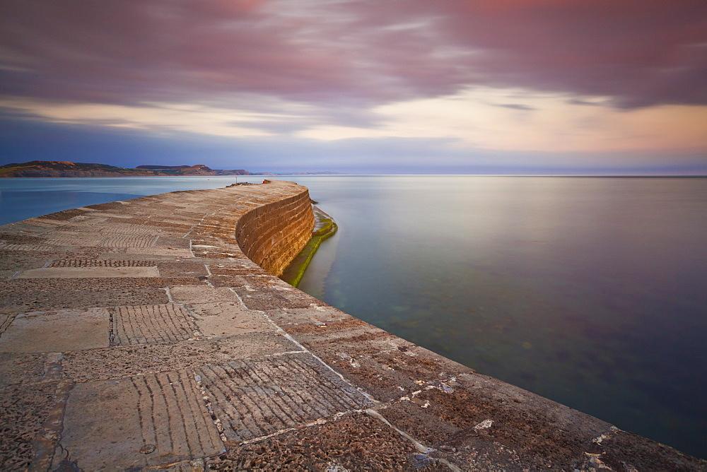 The stone Cobb or harbour wall, a famous landmark of Lyme Regis, Jurassic Coast, UNESCO World Heritage Site, Dorset, England, United Kingdom, Europe