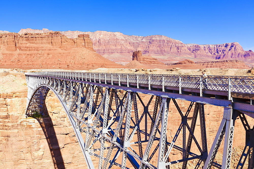 Lone tourist on Old Navajo Bridge over Marble Canyon and Colorado River, near Lees Ferry, Arizona, United States of America, North America