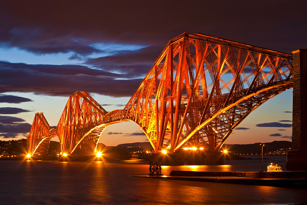 Forth Rail Bridge over the River Forth illuminated at night, South Queensferry, Edinburgh, Midlothian, Scotland, United Kingdom, Europe