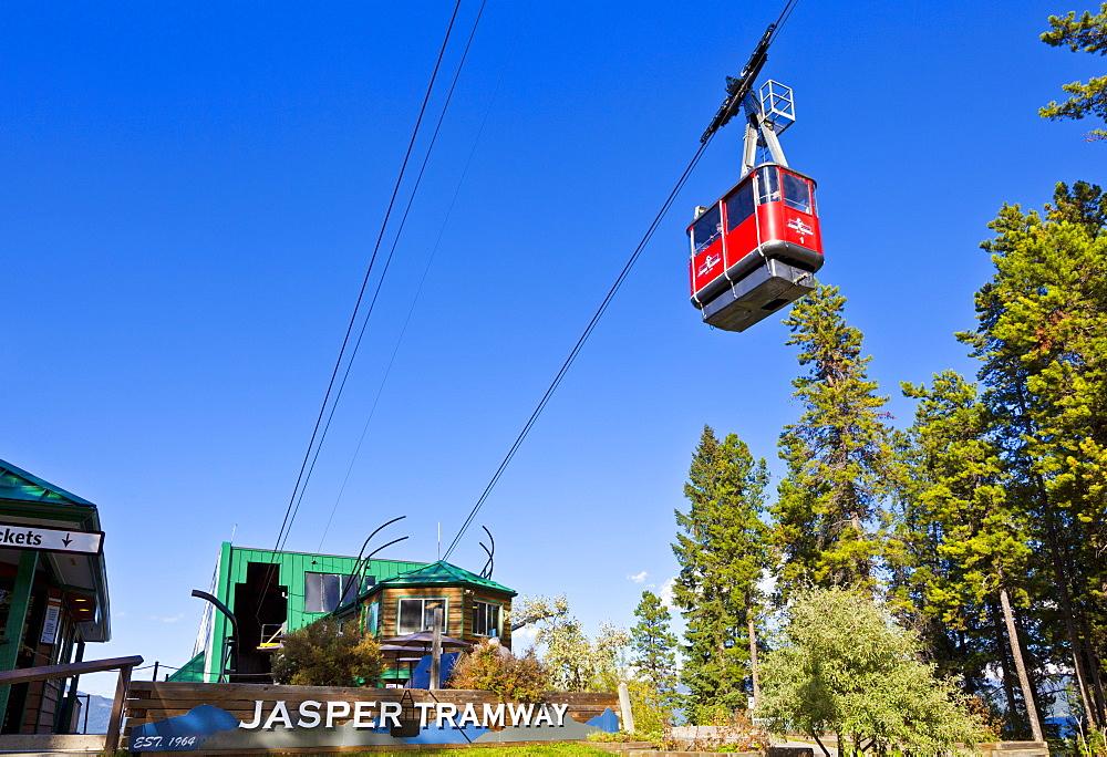 Red Gondola car on the Jasper tramway rising up Whistler mountain, Jasper National Park, Alberta, Canada, North America