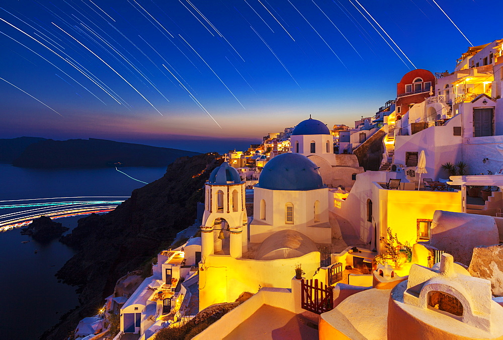 Oia village and churches with star trails after sunset, Santorini (Thira), Cyclades Islands, Greek Islands, Greece, Europe - 698-3083