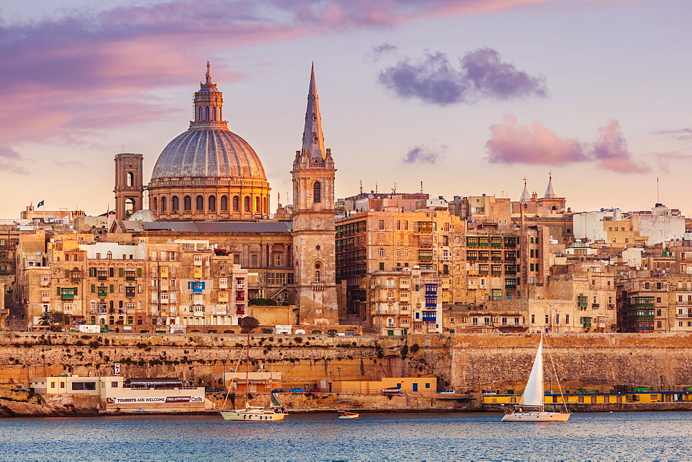 Valletta skyline at sunset with the Carmelite Church dome and St. Pauls Anglican Cathedral, Valletta, Malta, Mediterranean, Europe - 698-3095