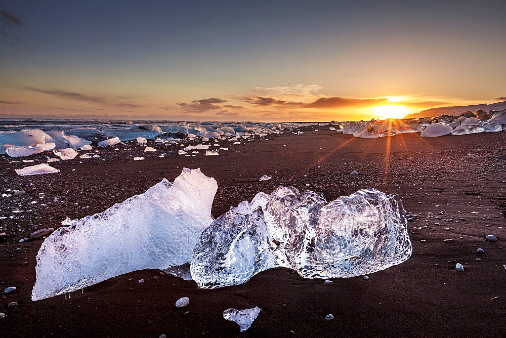 Broken ice from washed up icebergs on Jokulsarlon black beach at sunset, Jokulsarlon, southeast Iceland, Iceland, Polar Regions - 698-3113