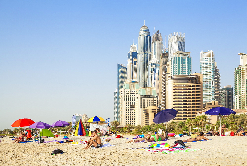 Sunbathers on the Public Dubai Beach at JBR (Jumeirah Beach Resort), Dubai, United Arab Emirates, Middle East