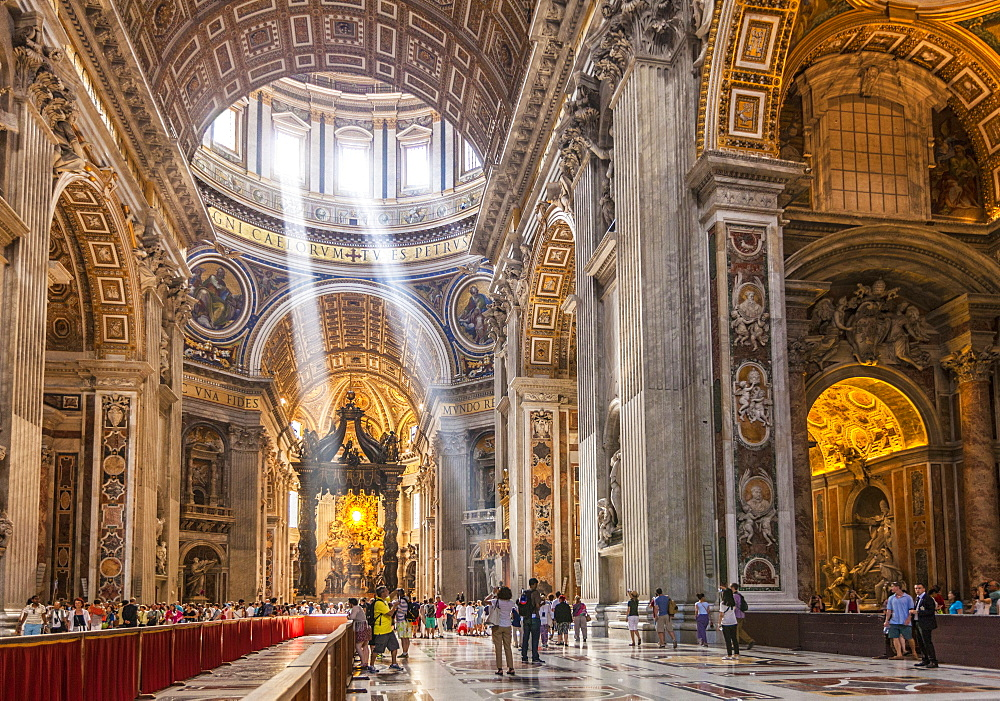 Interior of St. Peters Basilica with light shafts coming through the dome roof, Vatican City, UNESCO World Heritage Site, Rome, Lazio, Italy, Europe