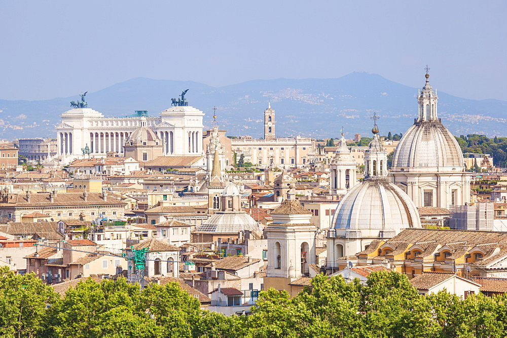Churches and domes of the Rome skyline showing Victor Emmanuel II monument in the distance, Rome, Lazio, Italy, Europe