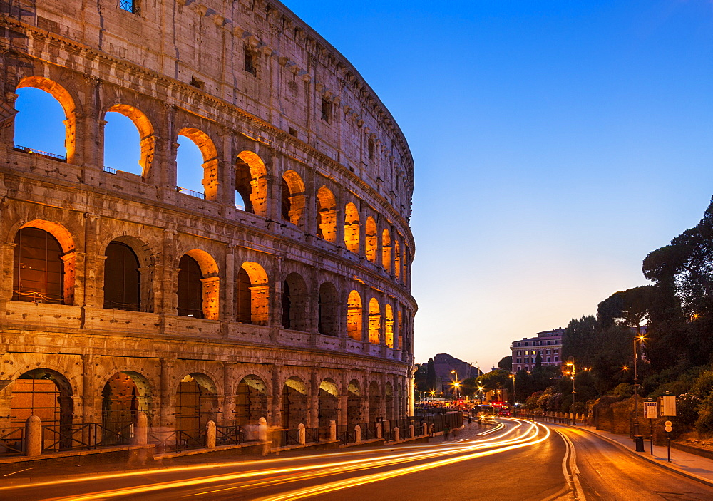 Rome Colosseum (Flavian Amphitheatre) at night with light trail, UNESCO World Heritage Site, Rome, Lazio, Italy, Europe