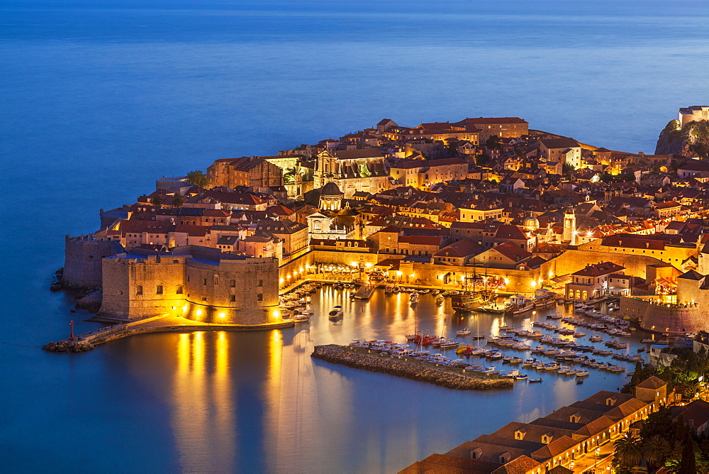 Aerial view of Old Port and Dubrovnik Old Town at night, UNESCO World Heritage Site, Dubrovnik, Dalmatian Coast, Croatia, Europe
