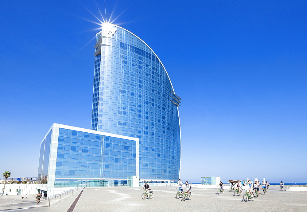 Cyclists outside the Hotel W at Barceloneta, Barcelona, Catalonia (Catalunya), Spain, Europe