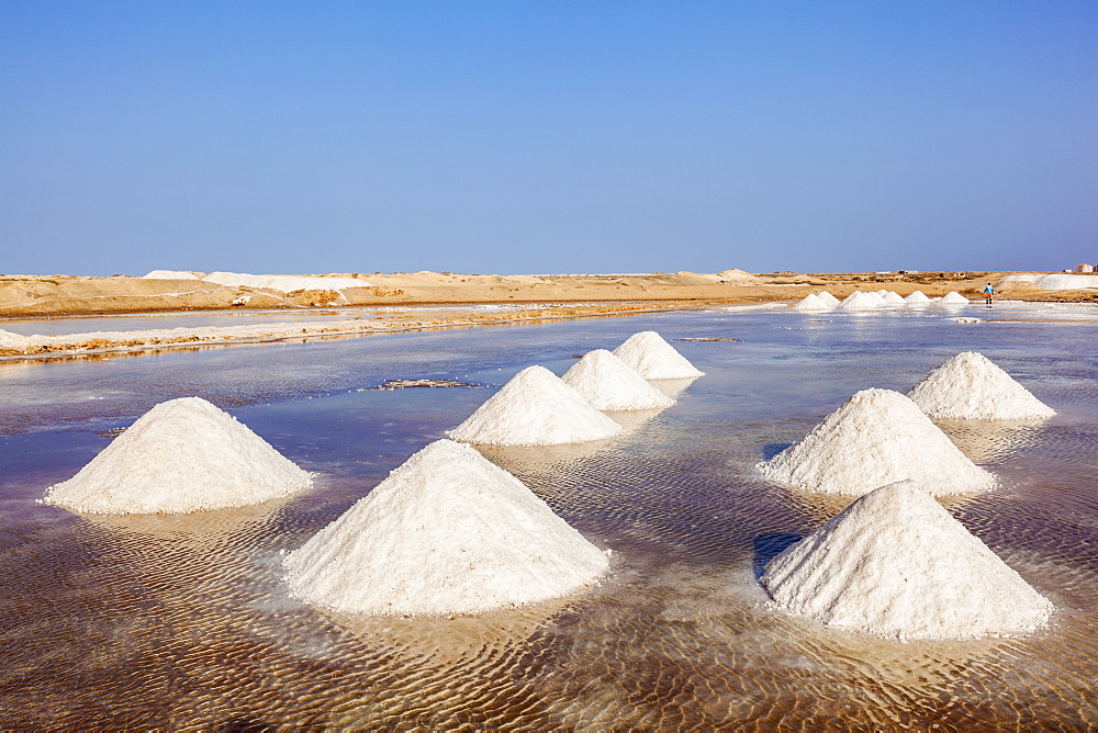 Piles of salt collected from natural salt pans at Salinas, just outside Santa Maria, Sal Island, Cape Verde, Atlantic, Africa