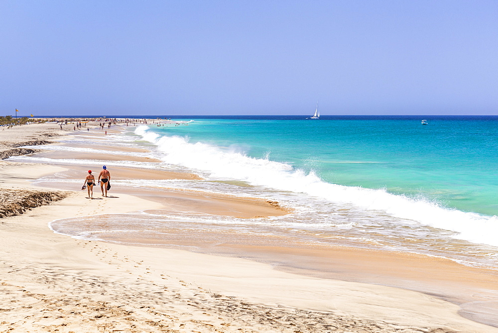 Tourists walking along the sandy beach, Ponta Preta beach, Santa Maria, Sal Island, Cape Verde, Atlantic, Africa