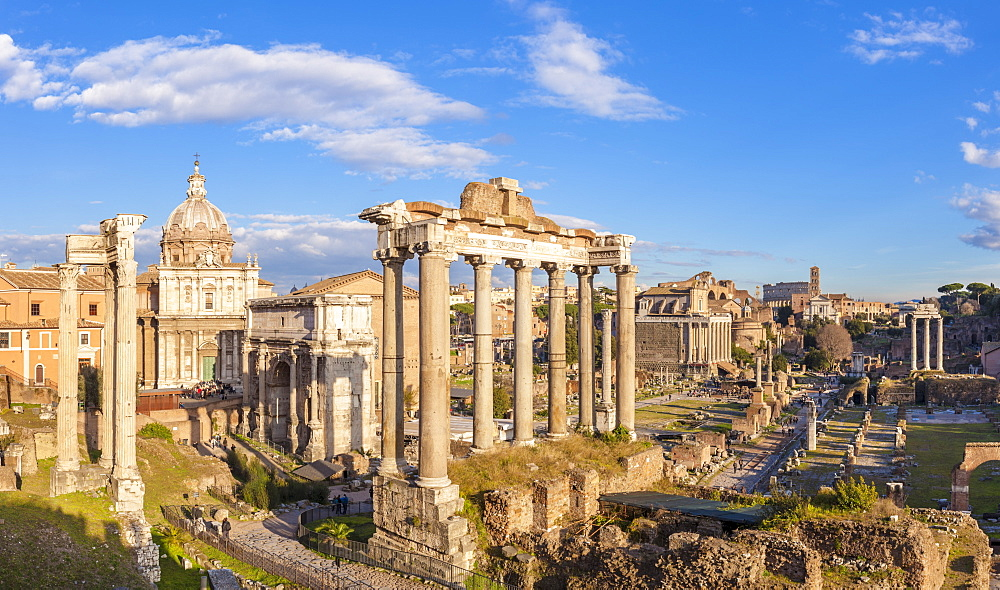 The columns of the Temple of Saturn and overview of the ruined Roman Forum, UNESCO World Heritage Site, Rome, Lazio, Italy, Europe