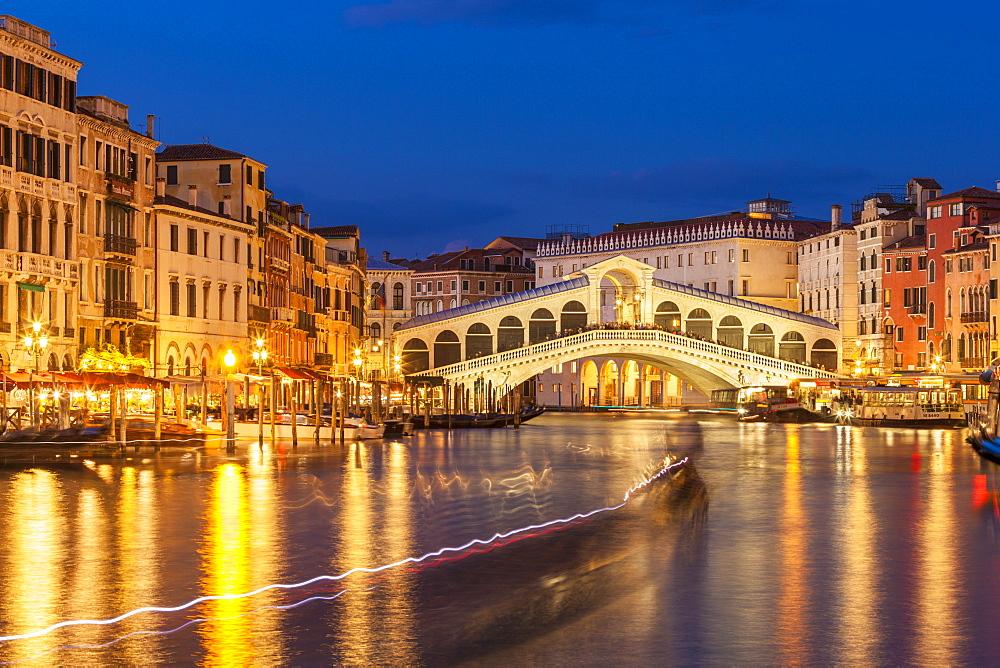 Rialto Bridge (Ponte di Rialto) at night with boat light trails on the Grand Canal, Venice, UNESCO World Heritage Site, Veneto, Italy, Europe - 698-3222