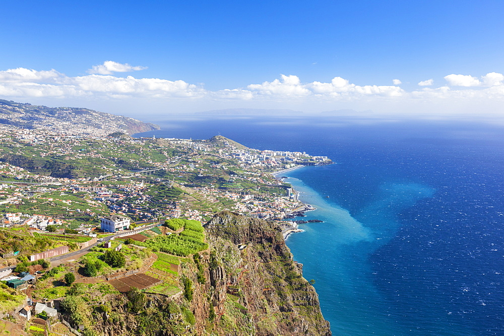 The southern coastline of Madeira towards Funchal from the high sea cliff headland Cabo Girao, Madeira, Portugal, Atlantic, Europe