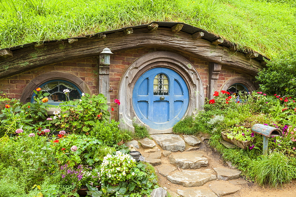 Hobbiton, wooden doors of Hobbit holes in the film set fictional village of Hobbiton, Matamata, North Island, New Zealand, Pacific