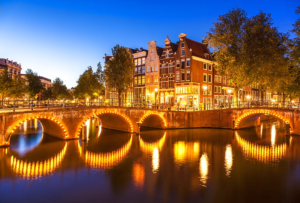 Illuminated bridges and reflections at night, Keizergracht and Leilesgracht canals, Amsterdam, North Holland, Netherlands, Europe - 698-3359