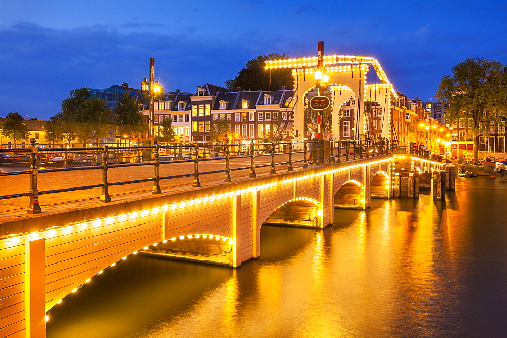 Illuminated Magere brug (Skinny Bridge) at night spanning the River Amstel, Amsterdam, North Holland, Netherlands, Europe - 698-3367