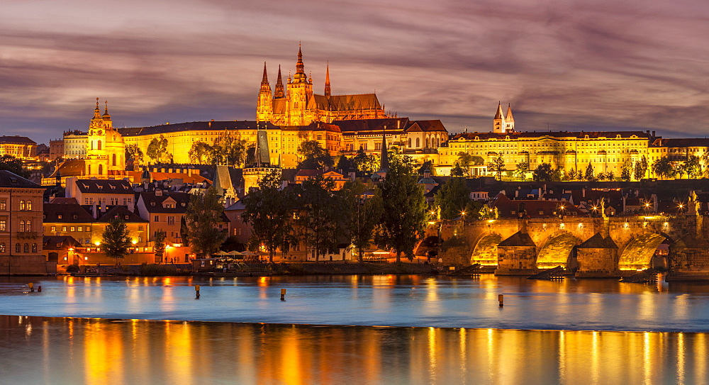 Prague skyline at night with Prague Castle, St. Vitus Cathedral, Mala Strana and Charles Bridge, UNESCO World Heritage Site, Prague, Czech Republic, Europe