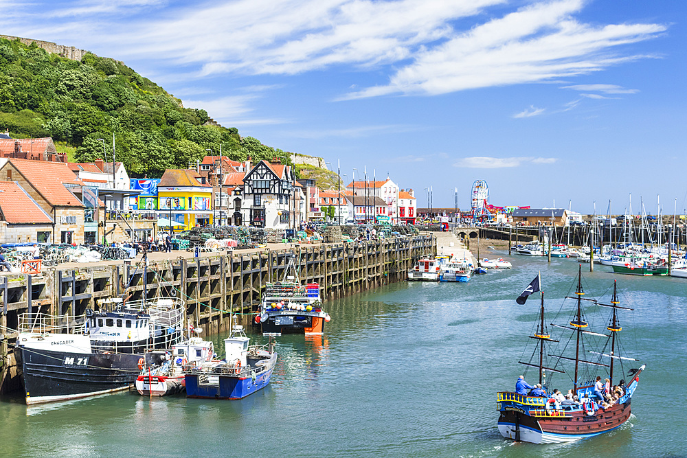 Tourist boat trips from Scarborough harbour in south bay Scarborough North Yorkshire England UK GB Europe