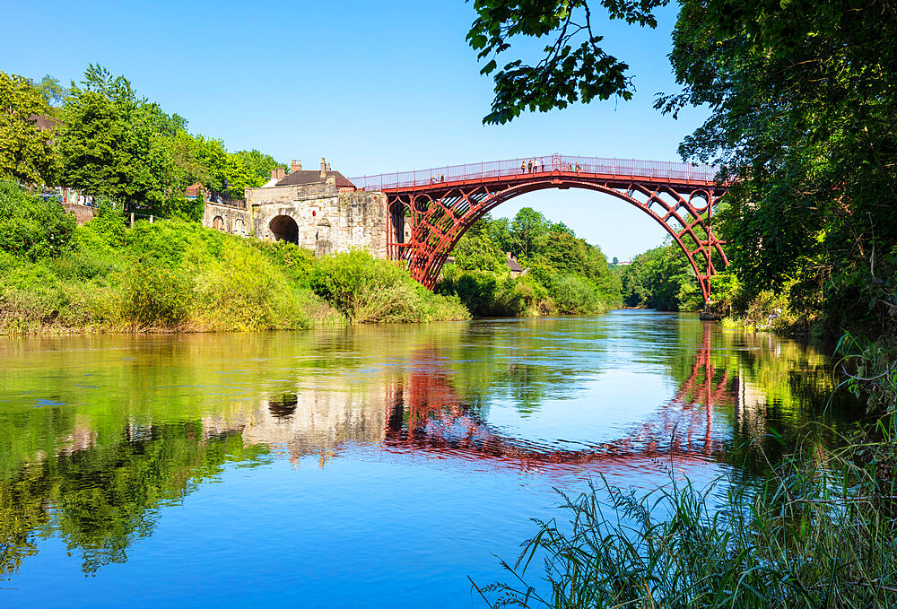 Red Ironbridge bridge over river Severn with reflection Ironbridge gorge Iron bridge Shropshire England GB UK europe