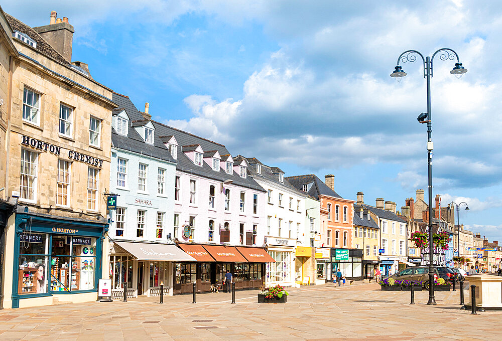Shops and businesses on the Market place Cirencester town centre Cirencester Wiltshire england UK GB Europe