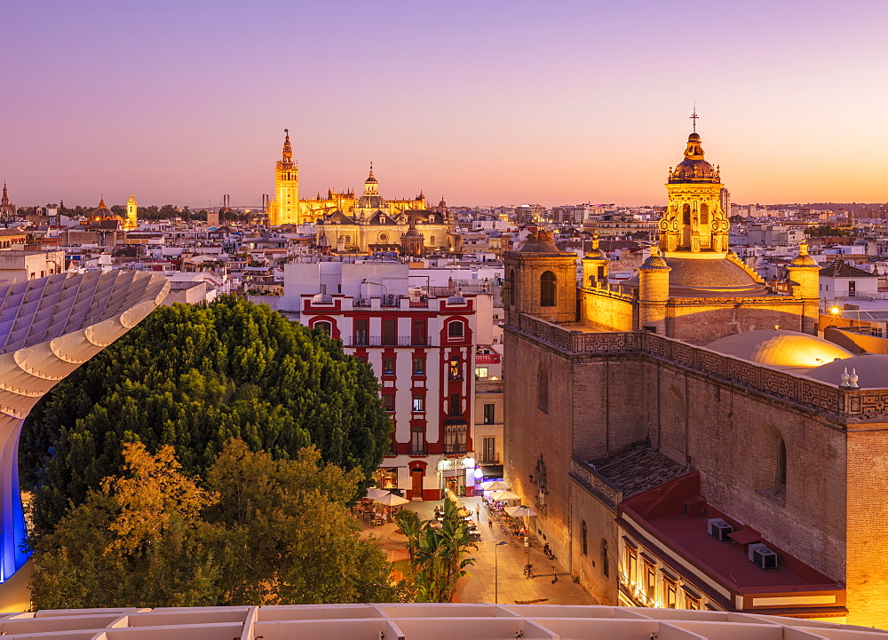 Sunset Seville skyline of Cathedral and city rooftops from the Metropol Parasol, Seville, Andalusia, Spain, Europe