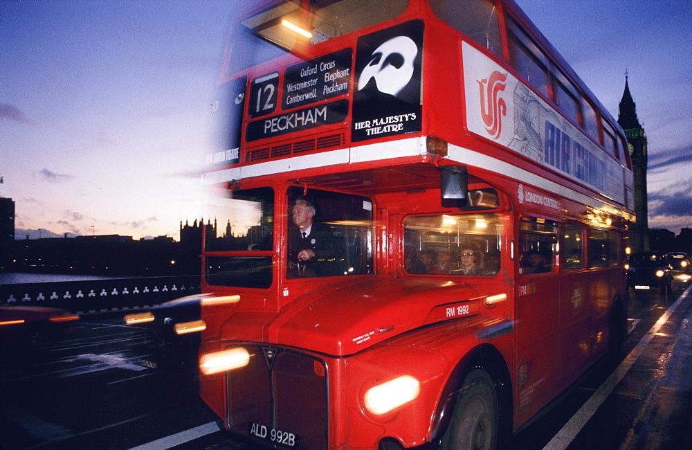 Double-decker bus going over Westminster Bridge, London