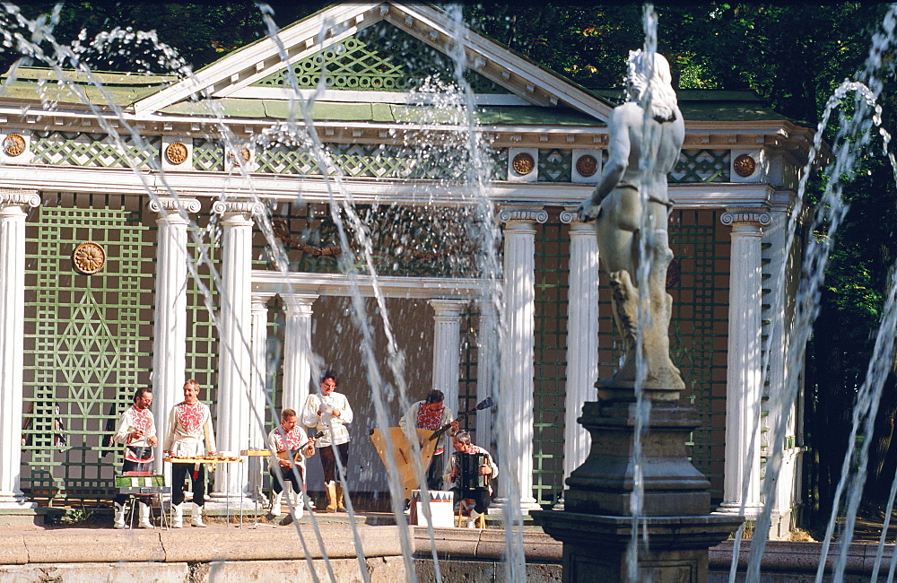 Band playing music in the grounds of Pedrovorets Castle and fountain, St Petersburg