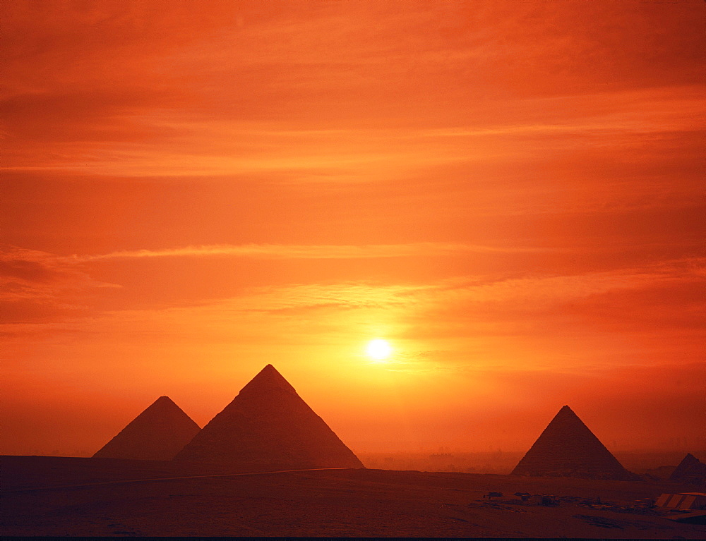 The pyramids silhouetted at dusk, Giza, Cairo, Egypt, Africa