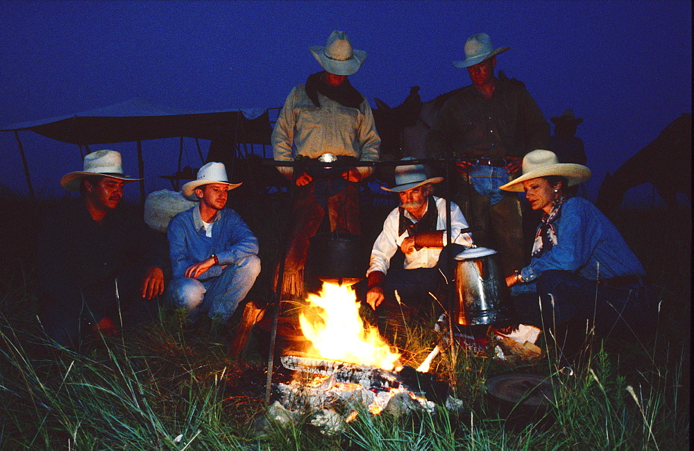 Cowboys around camp fire, Fort Worth