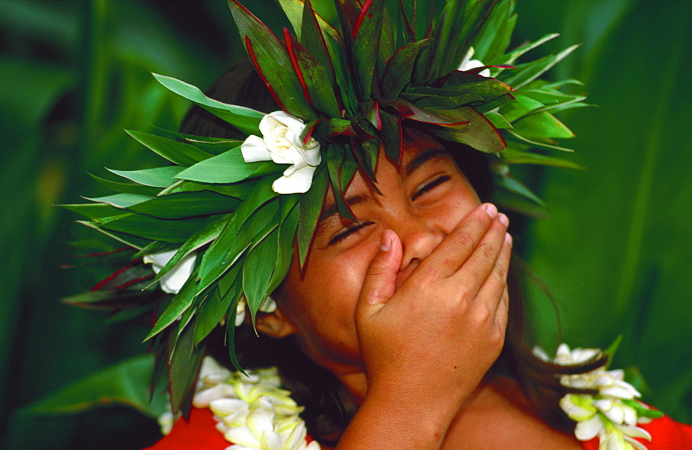 Portrait of laughing girl with her hand over her mouth, Tahiti, French Polynesia, Pacific Islands