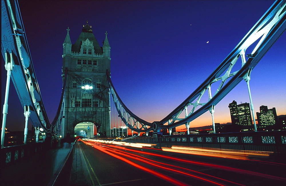 Blurred traffic crossing Tower Bridge at night, London, United Kingdom, Europe