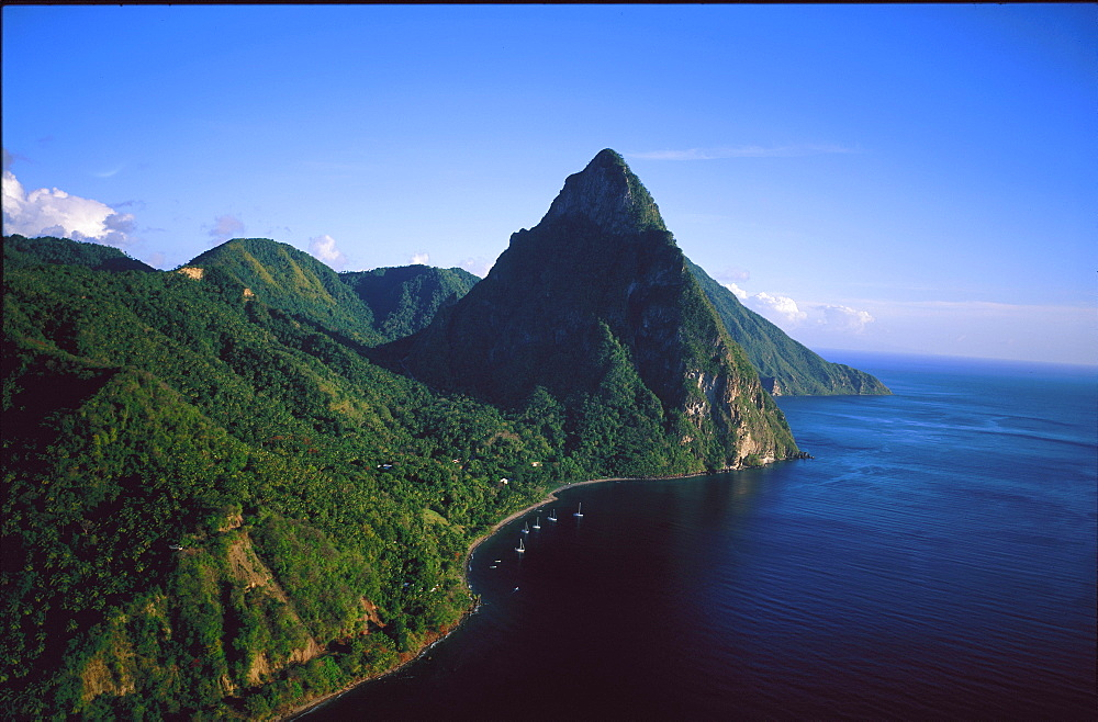 Aerial view over boats moored off a beach below the Petit Piton, St Lucia