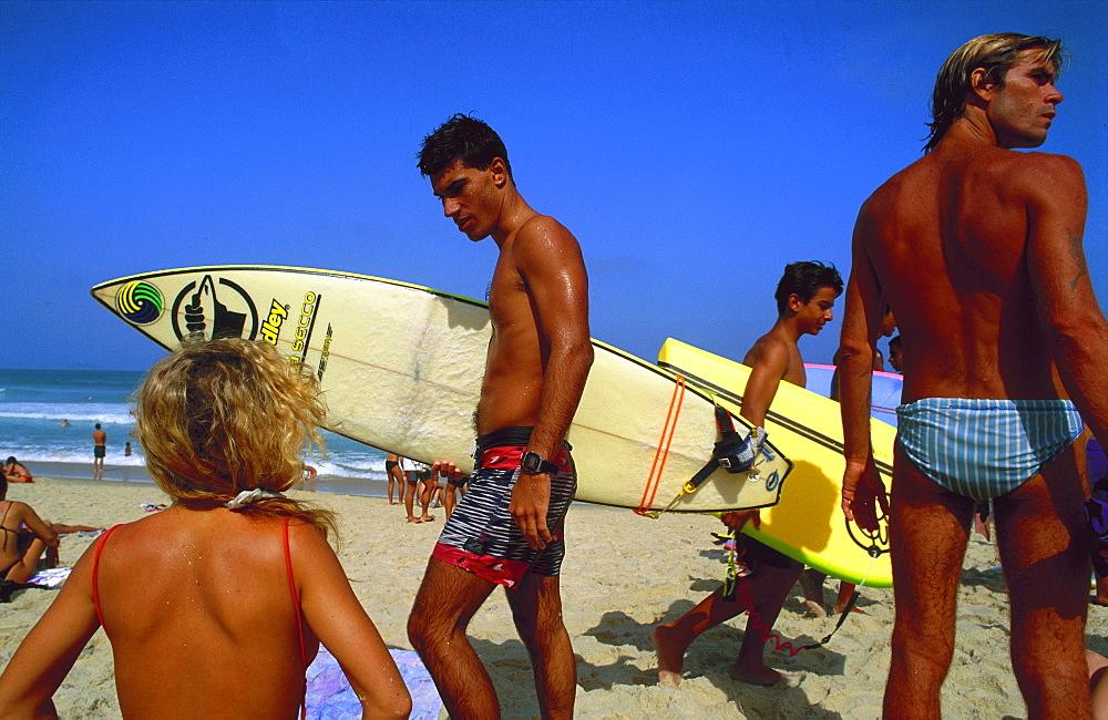Surfers on Copacabana beach, Rio de Janeiro, Brazil