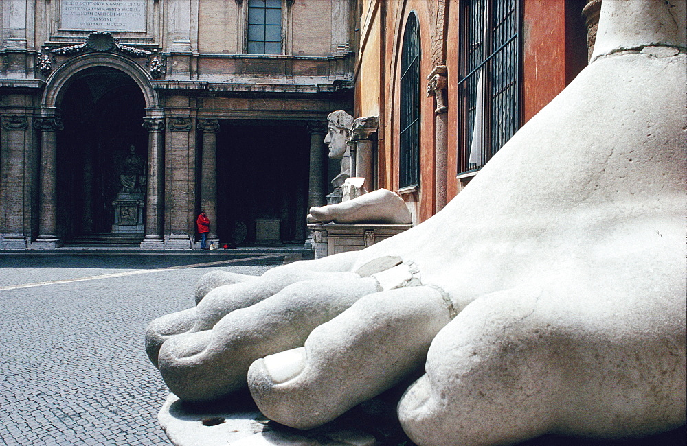 Foot of the Cesar statue and the Conservatory Museum, Rome