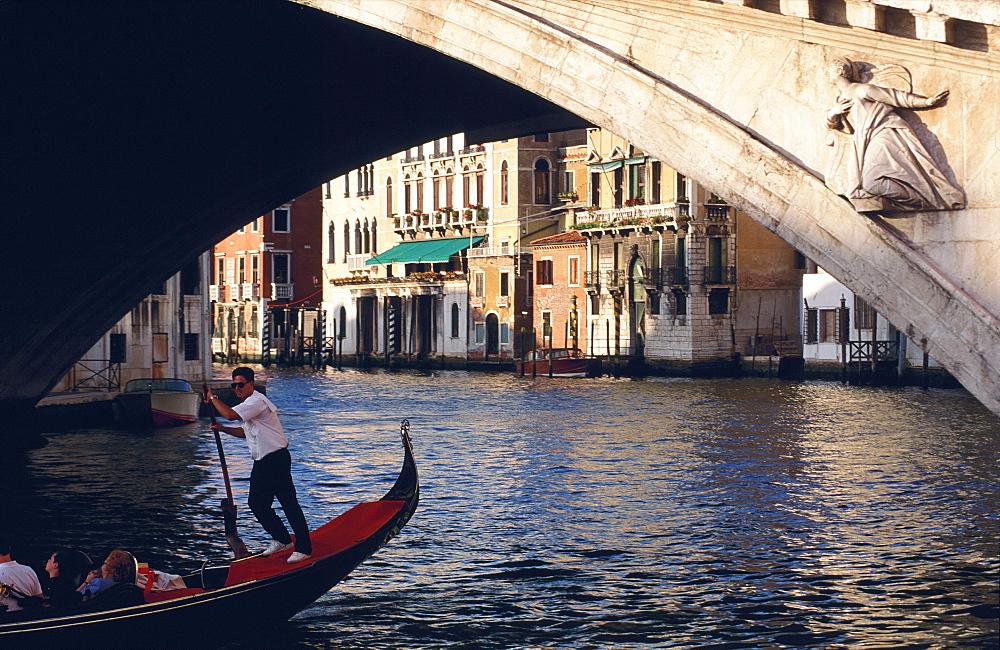 Gondola beneath the Rialto Bridge, Venice